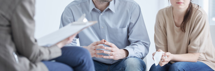Conflicted husband and wife during divorce mediation with psychologist