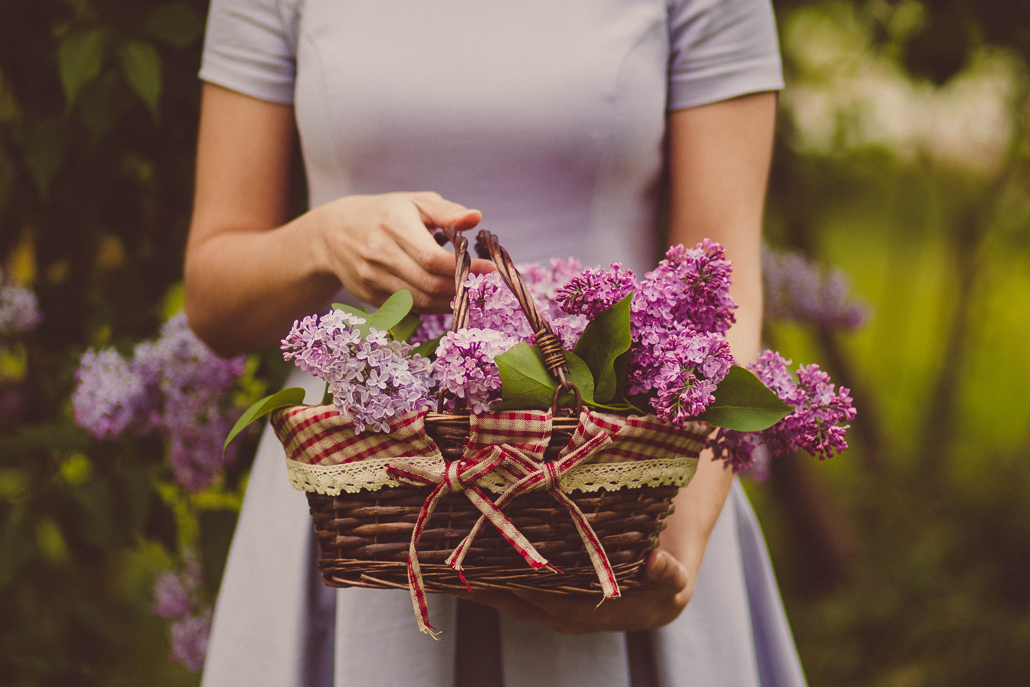 A woman carries a basket of flowers
