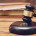 Wooden judge gavel and golden rings,  divorce concept