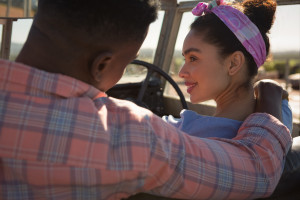 Couple romancing in a car at countryside