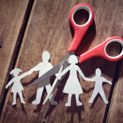 Divorce and child custody scissors cutting family apart