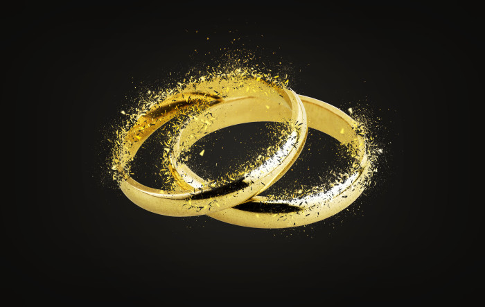 Old wedding rings Shattering on black background